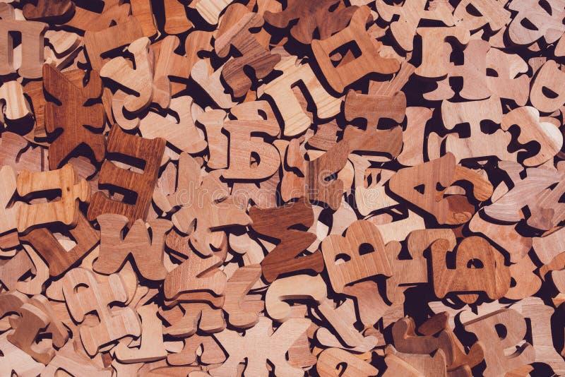 堆木斯拉夫在字母表上写字 库存照片