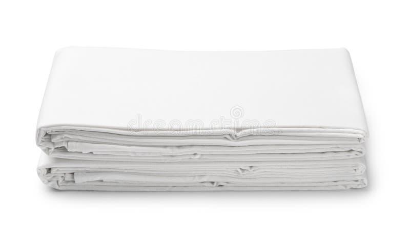 堆白色被折叠的卧具板料 免版税库存图片