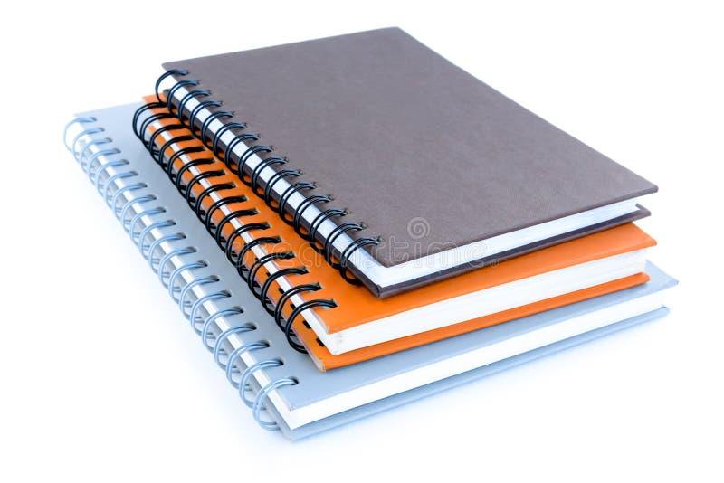 堆笔记本或习字簿在白色背景 免版税图库摄影