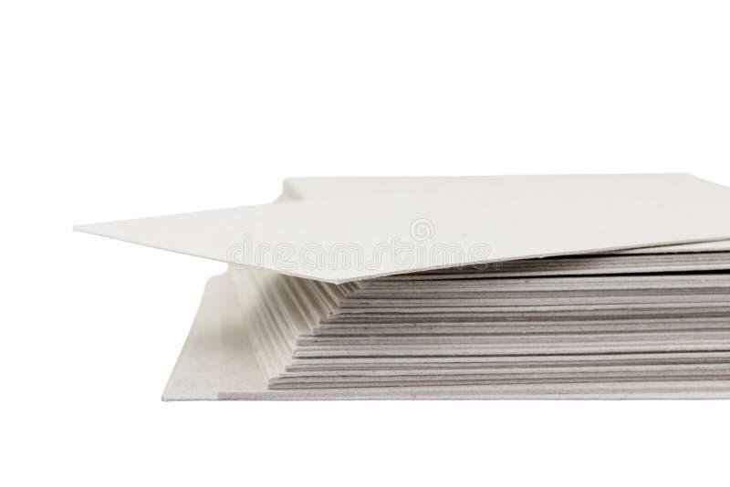 堆纸板特写镜头在白色背景的 免版税库存照片