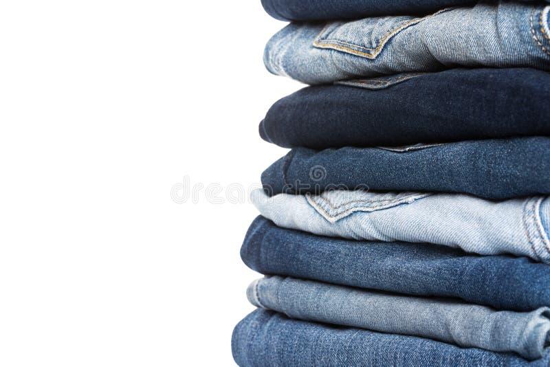 堆蓝色牛仔裤各种各样的树荫  免版税库存照片