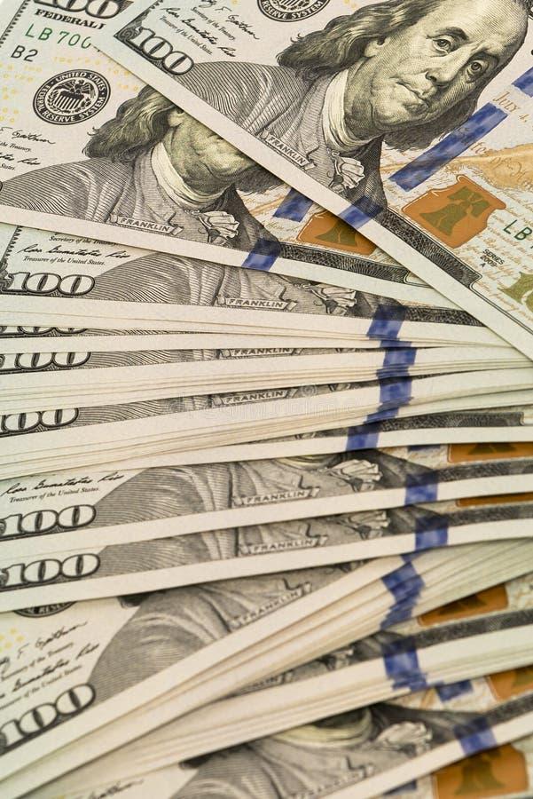 堆金钱以美元兑现钞票 免版税图库摄影