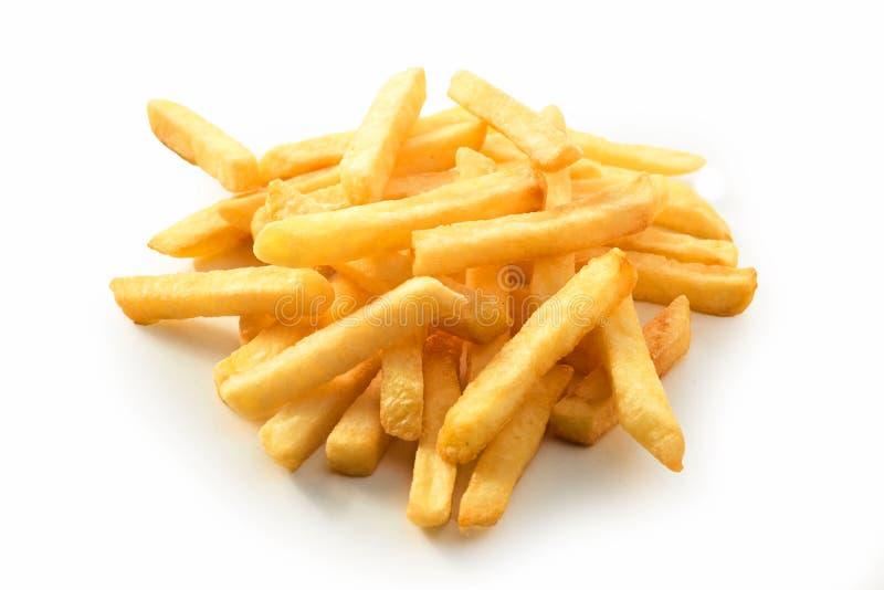 堆金黄酥脆被油炸的薯片 免版税库存图片