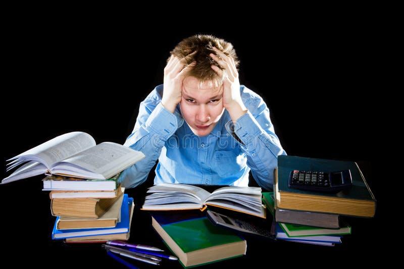 堆o疲倦的少年课本是 库存图片