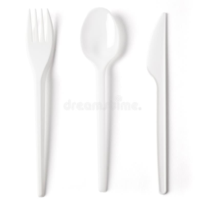 塑料叉子匙子和刀子在白色 库存图片