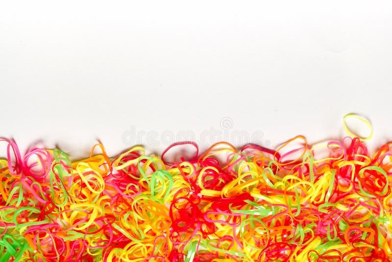 塑料带明亮的五颜六色的背景  免版税库存照片