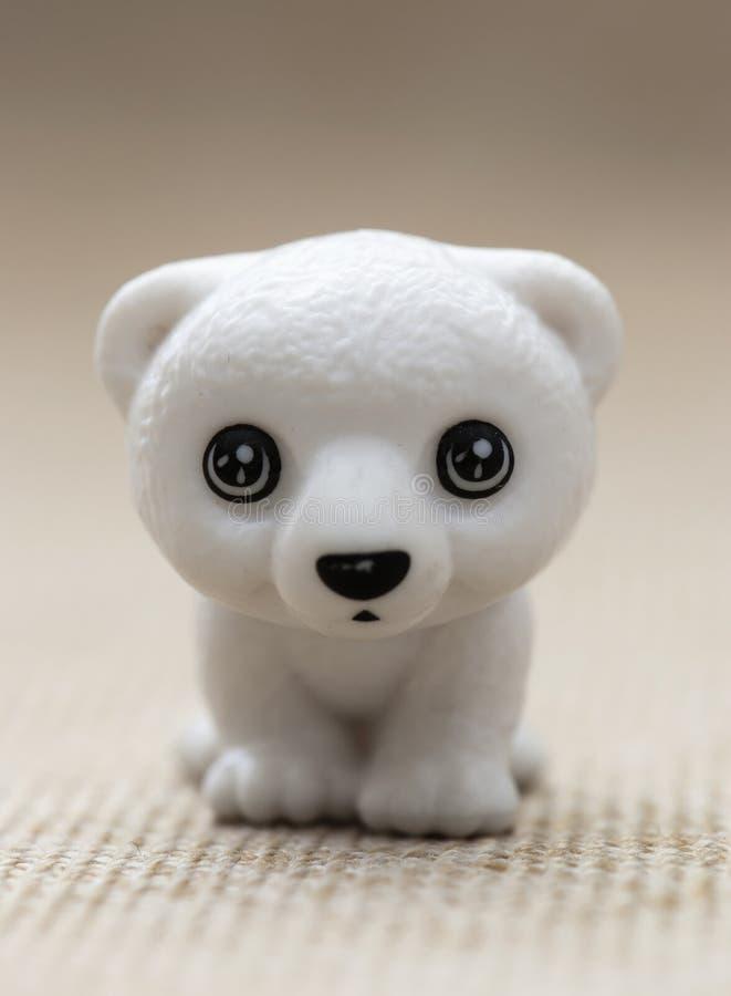 塑料玩具小雕象â崽熊 免版税库存照片