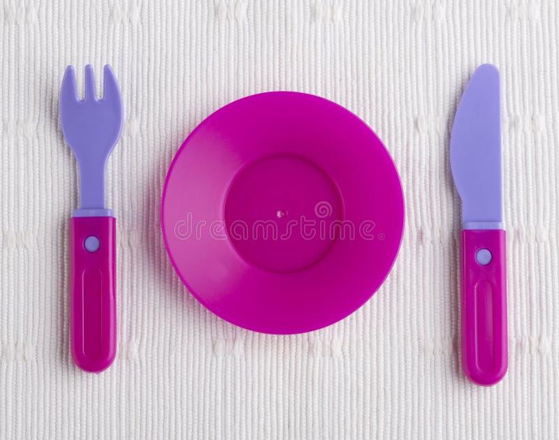 塑料碗筷玩具 库存照片