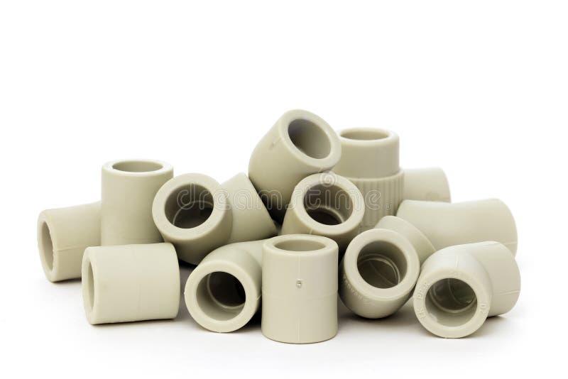 塑料管子的很多联合的配件 免版税库存图片