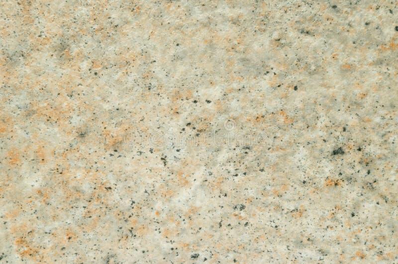 塑料纹理与米黄石表面的模仿的 免版税库存图片