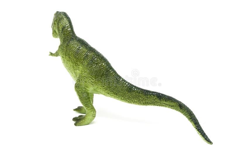 塑料绿色暴龙雷克斯恐龙玩具后面 库存照片