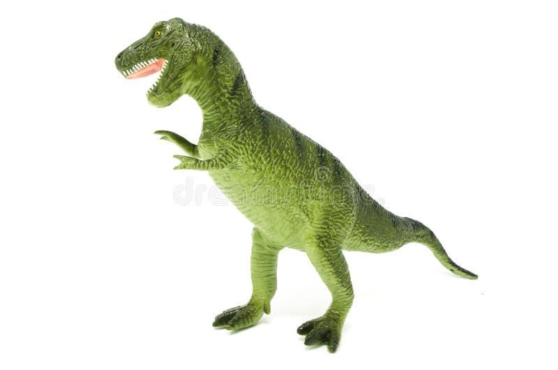 塑料绿色暴龙雷克斯恐龙玩具边/前面 库存照片