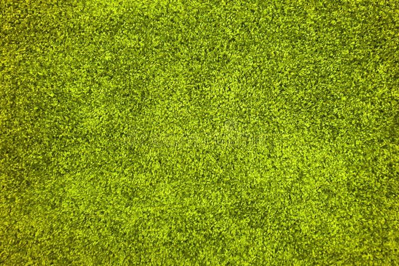 塑料绿草地毯纹理 库存照片