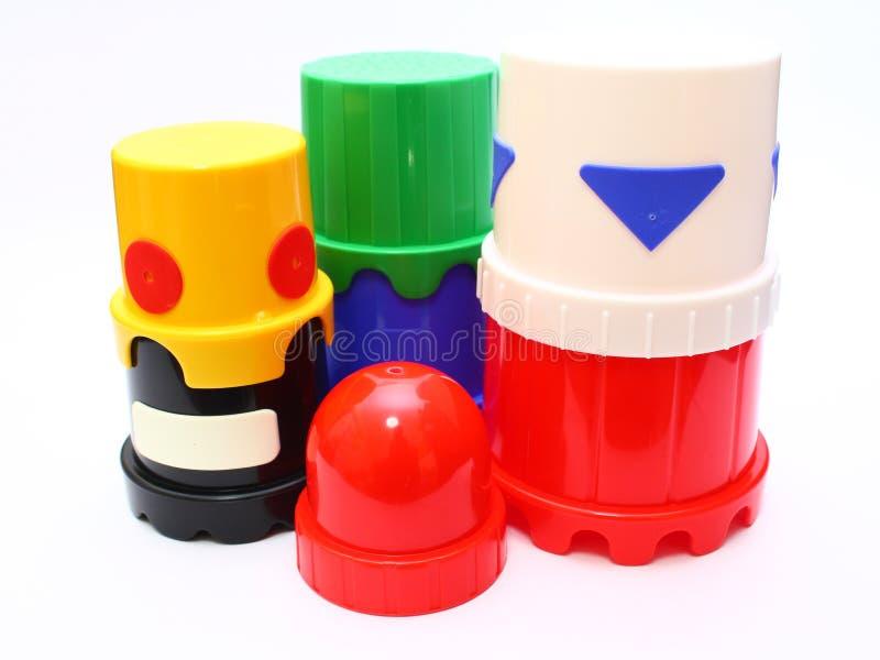 塑料被堆积的玩具 免版税库存图片