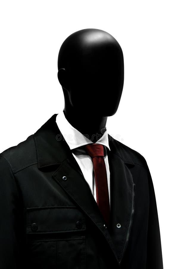 塑造在典雅的黑衣服的时装模特与红色领带 免版税库存图片