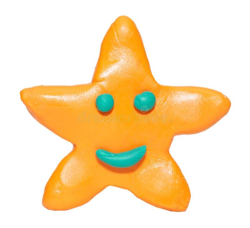 塑造微笑的星形的黏土 免版税库存照片