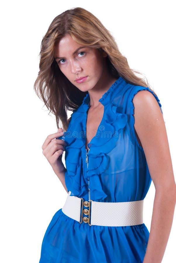 塑造蓝色的妇女c通过女衬衫、胸罩和白色传送带 库存照片