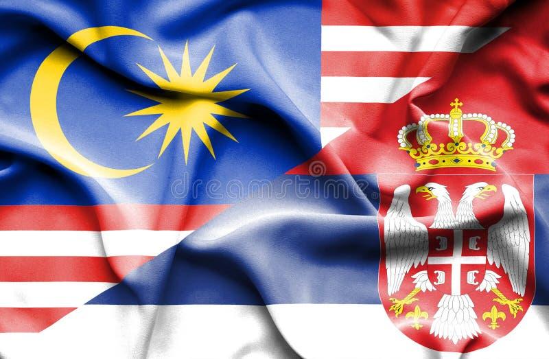塞尔维亚和马来西亚的挥动的旗子 皇族释放例证