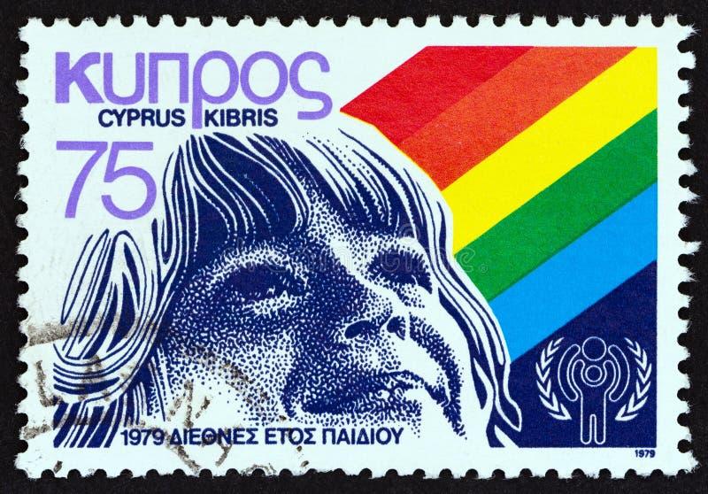 塞浦路斯-大约1979年:在塞浦路斯打印的邮票发布了孩子的国际年显示柴尔兹面孔,大约1979年 免版税库存图片