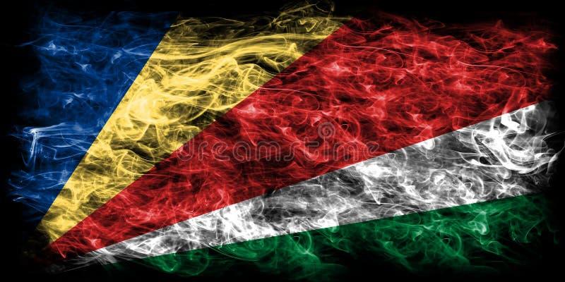 塞舌尔群岛在黑背景的烟旗子 库存照片