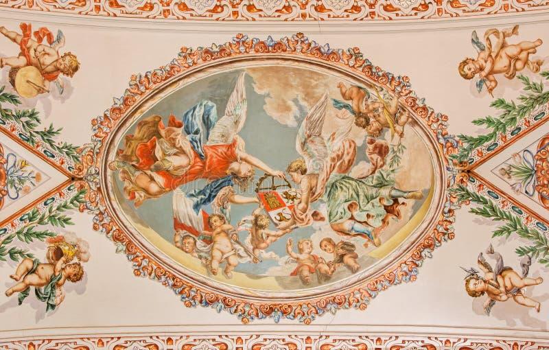 塞维利亚-天使壁画与符号冠的在天花板在教会Hospital de los Venerables Sacerdotes里 免版税库存照片