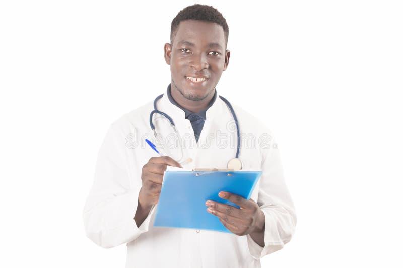 填好一个医疗形式的医生 免版税库存图片