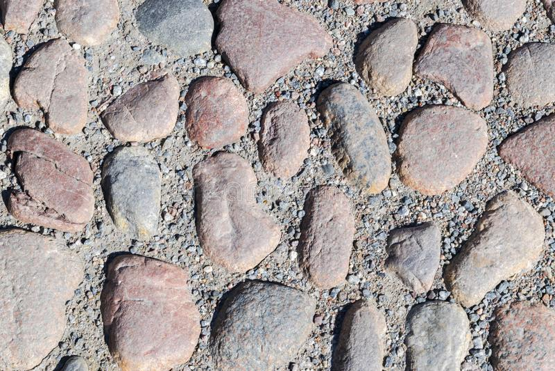 墙壁圆的石岩石纹理背景 色的光滑的石头背景  光滑的石头纹理背景  石样式 库存照片