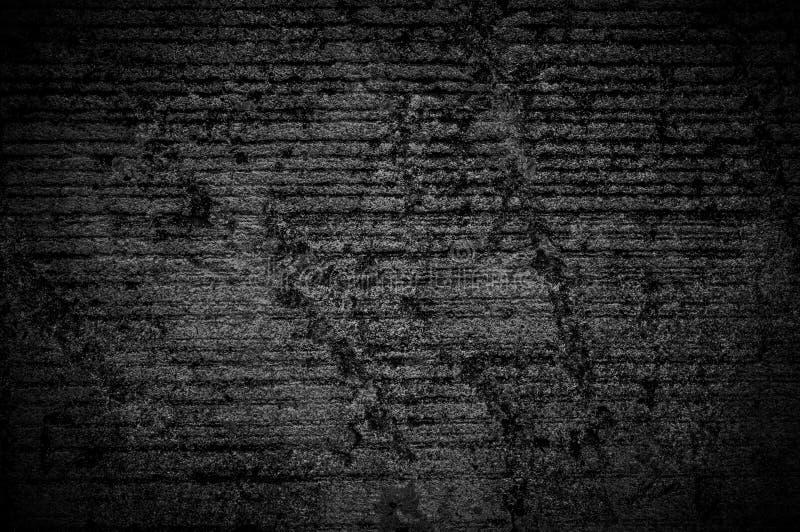 墙壁难看的东西黑混凝土有轻的背景 肮脏,尘土墙壁具体黑板纹理和飞溅白色彩色空间tex的 图库摄影