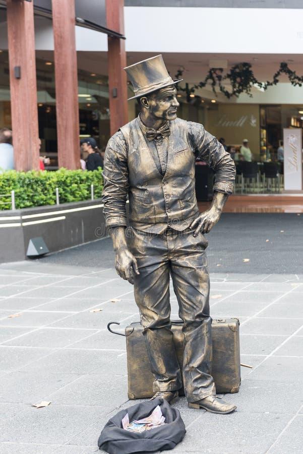 墨尔本卖艺人-居住的雕象有趣的游人在墨尔本,澳大利亚 免版税库存图片