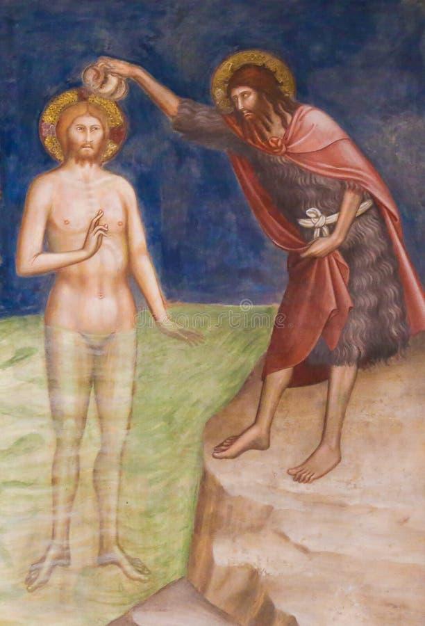 壁画在圣吉米尼亚诺-耶稣基督洗礼  库存图片