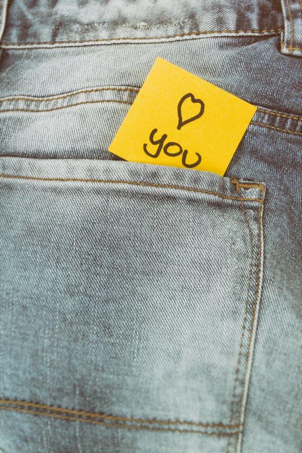 备忘录笔记我爱你,裤子口袋 免版税图库摄影