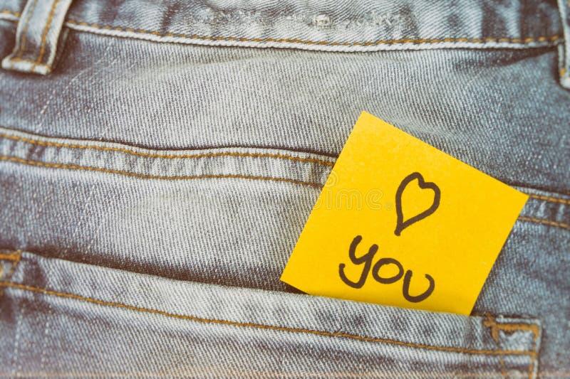 备忘录笔记我爱你,裤子口袋 免版税库存照片