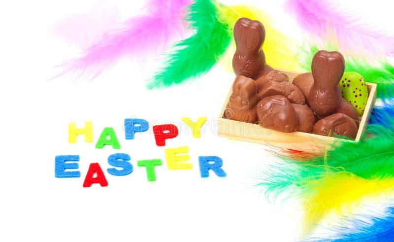 复活节卡片,在复活节篮子的巧克力 免版税库存图片