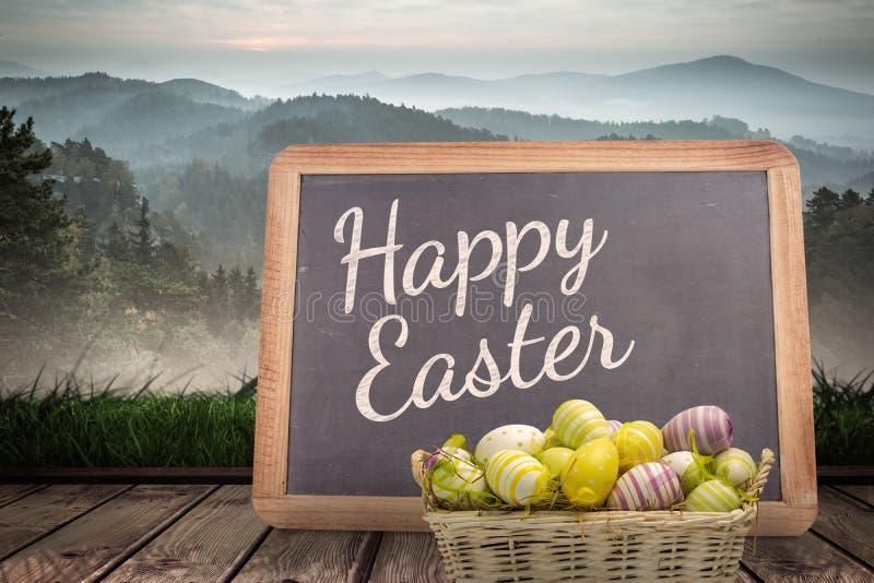 复活节彩蛋的一个综合图象在篮子的 免版税库存照片