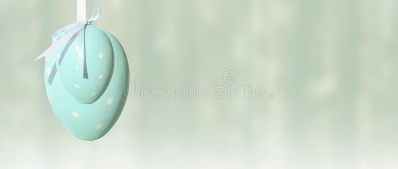 复活节彩蛋,丝带,蓝色柔和的淡色彩,横幅,背景 免版税库存照片