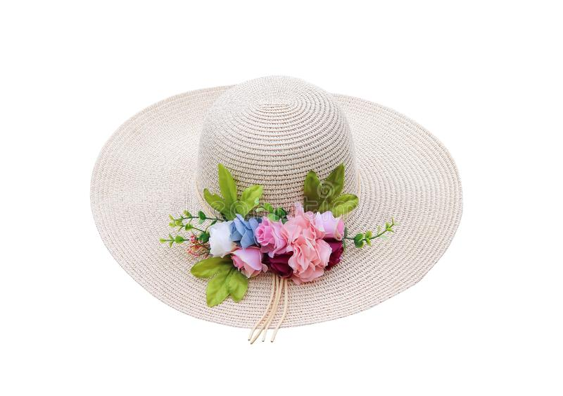 夏天有在与裁减路线的白色背景隔绝的装饰塑料五颜六色的开花花的妇女帽子 库存照片