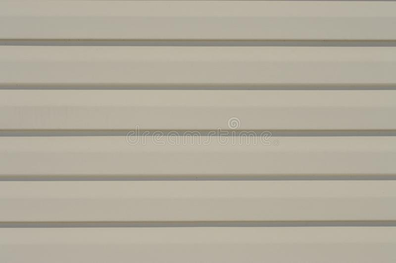 外墙金属的乙烯基支持的家具 图库摄影
