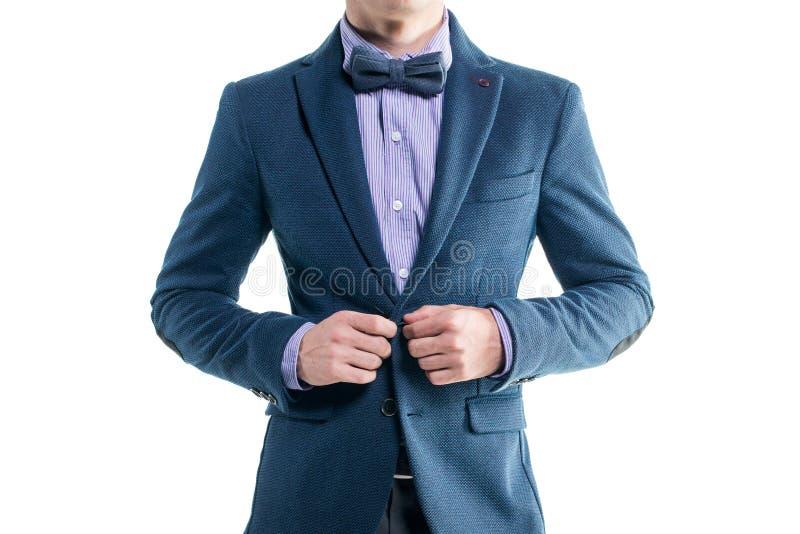外套无尾礼服的英俊的典雅的年轻时尚人 免版税库存照片