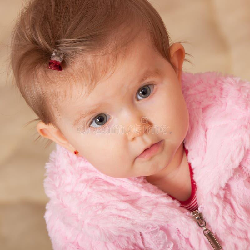 外套毛皮粉红色小孩 免版税图库摄影