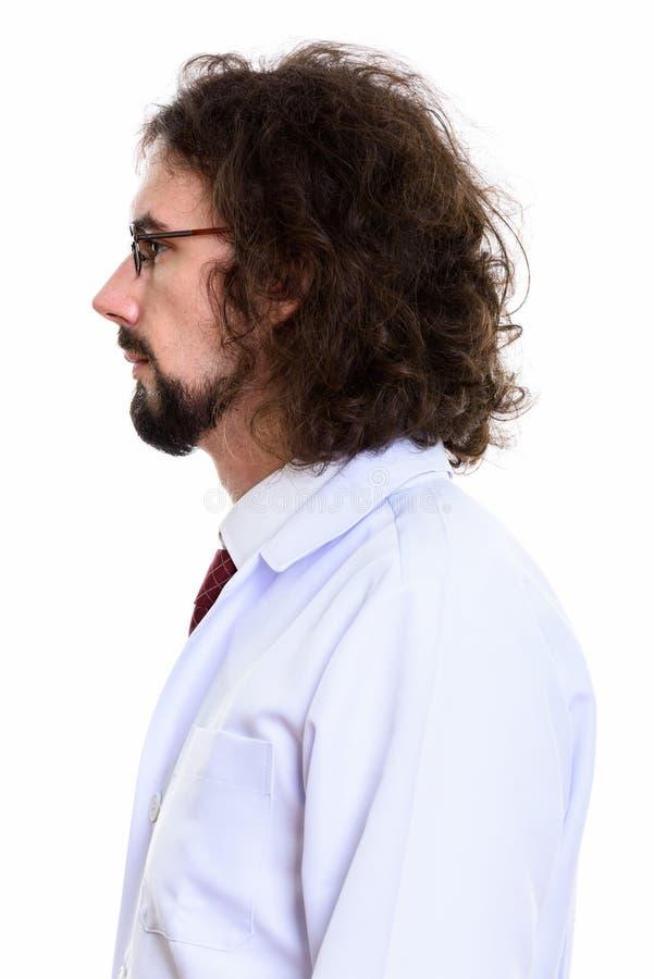 外形观点的有胡子和卷发的帅哥医生 免版税图库摄影