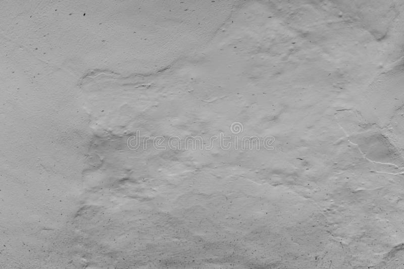 外部织地不很细墙壁被绘白色,与灰泥涂抹的表面的照片的关闭,伟大为背景 图库摄影