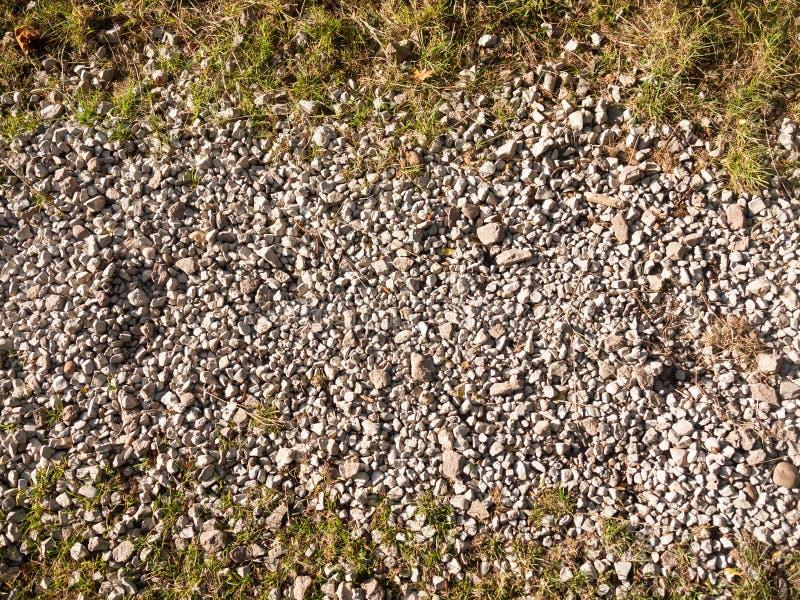 外面白色灰色石大卵石道路地板 免版税库存照片