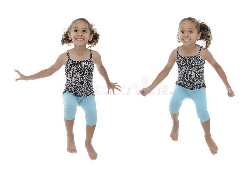 多个姿势愉快女孩跳跃 库存照片