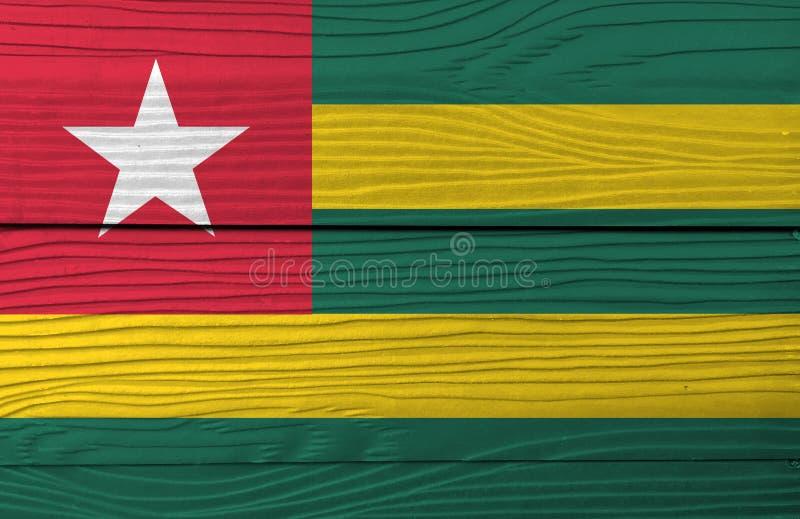 多哥的旗子木板材背景的 难看的东西多哥旗子纹理 皇族释放例证