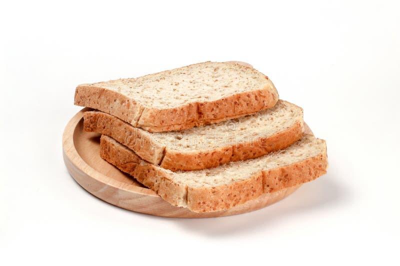 多士麦子面包在木板材切了 免版税库存照片
