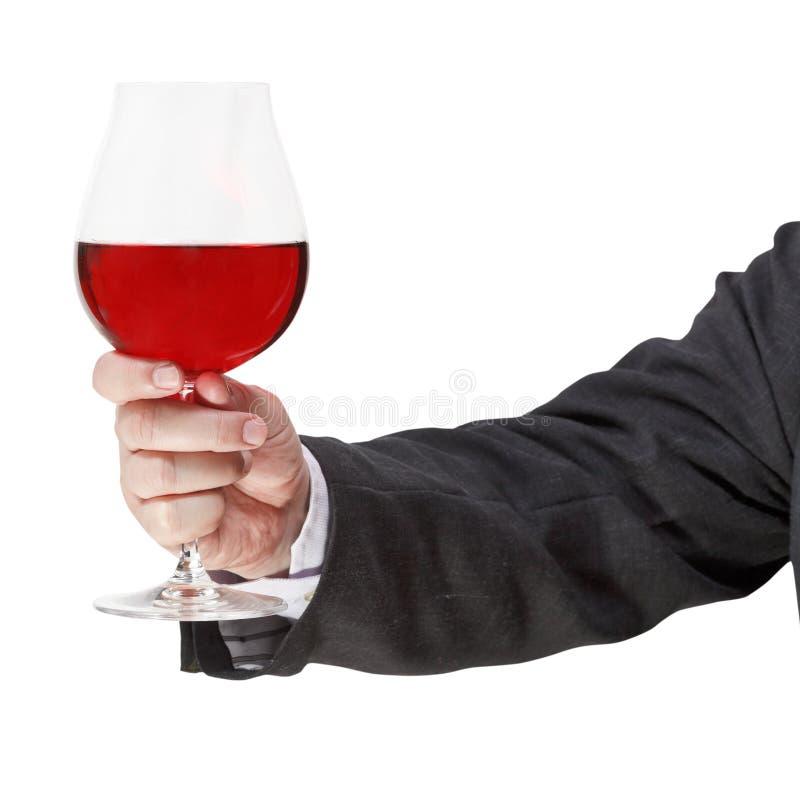 多士withred酒杯在商人手上 图库摄影