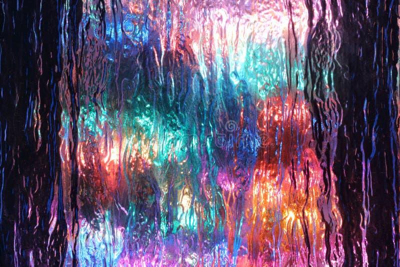 多彩多姿的光可看见的通过织地不很细玻璃 图库摄影