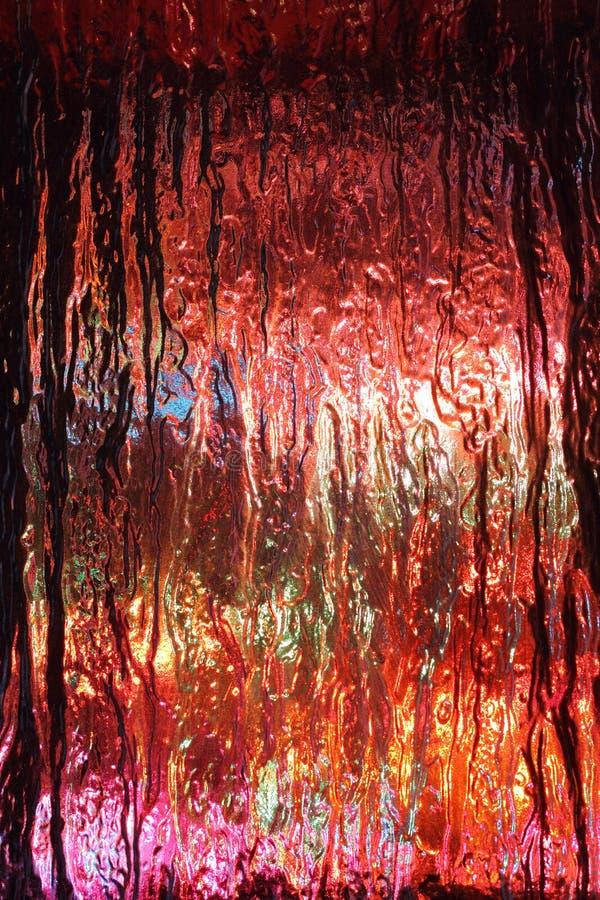多彩多姿的光可看见的通过织地不很细玻璃 免版税库存照片