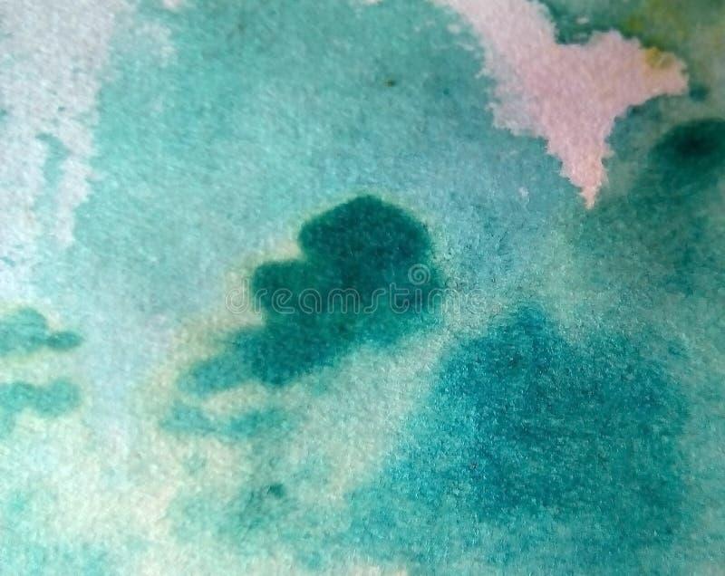 多彩多姿的水彩污点特写镜头在纸的 黄色,绿色,蓝色,棕色污点,滴水,下落 免版税库存图片