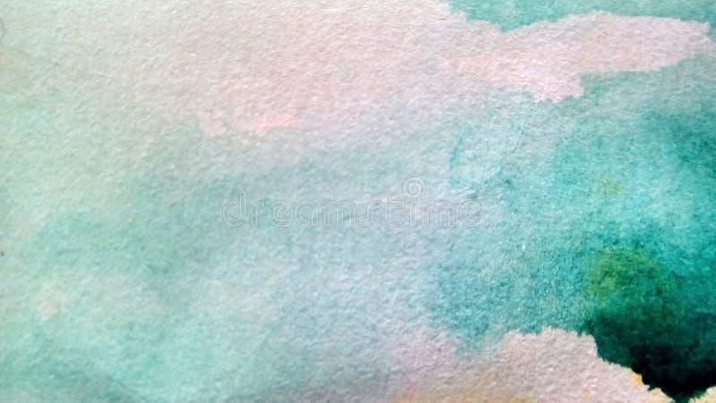 多彩多姿的水彩污点特写镜头在纸的 黄色,绿色,蓝色,棕色污点,滴水,下落 库存照片
